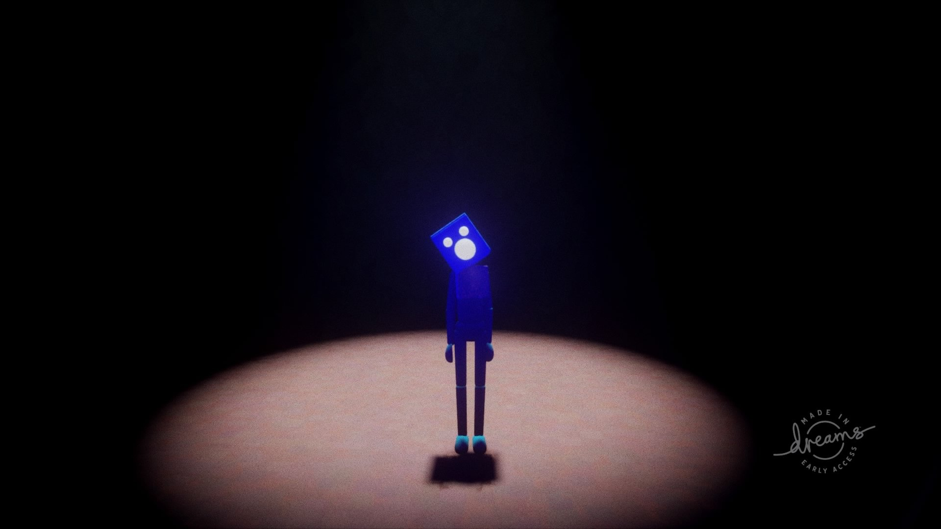 Blue character standing in spotlight from Dreams