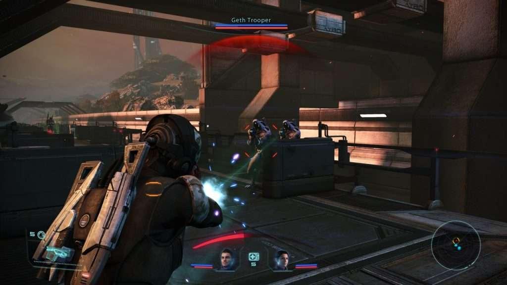 Commander Shepard Shoots at Geth in Mass Effect Legendary Edition